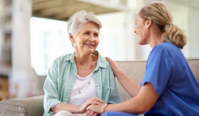 nurse and older patient
