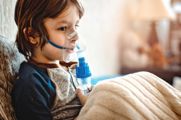 Young buy using nebuliser