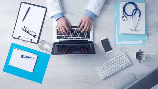 Doctor working at laptop