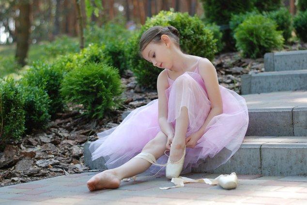 Ballerina tying her shoes