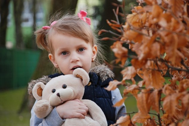 Girl with toy bear