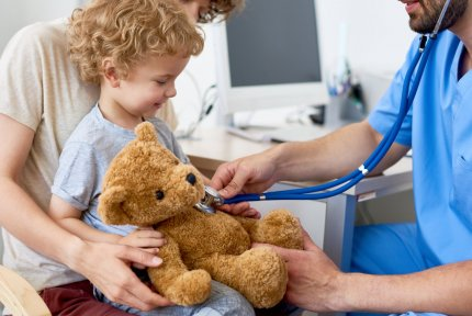 Doctor playing with child