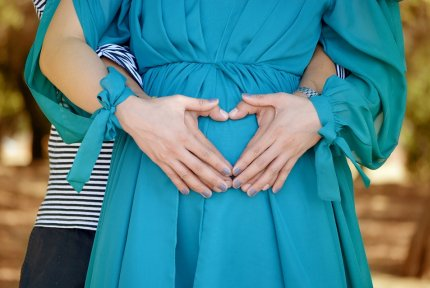 Pregnany woman blue dress