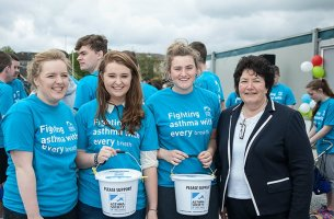 Fundraisers with collection buckets for the Asthma Society of Ireland
