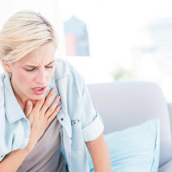 Blonde woman having breathing difficulties