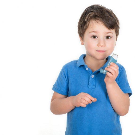 Little boy with reliever inhaler