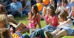 Festival Goers sitting on grass