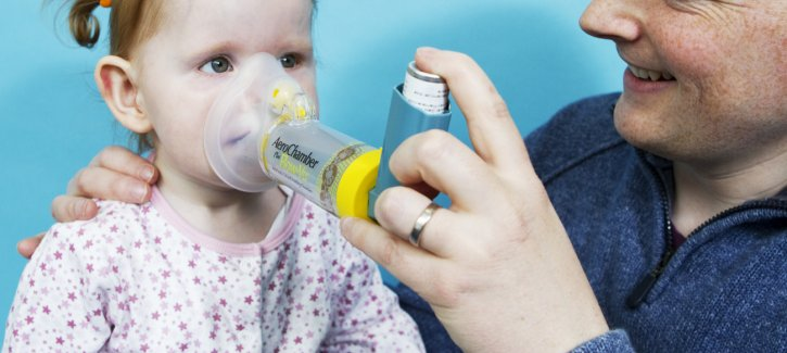Child using a Spacer to take asthma medication