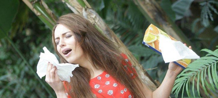 Girl Sneezing & Reading Asthma & Hayfever Information Booklet