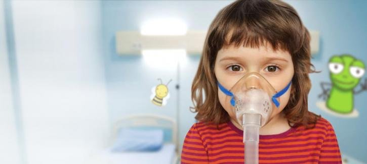 Asthmatic girl with an oxygen mask on in hospital