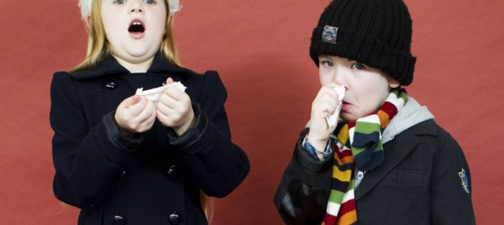 One child sneezing, the other sniffling during flu season