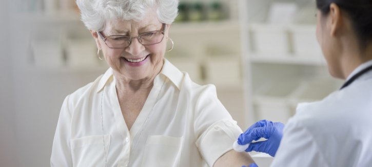 Older woman getting flu jab