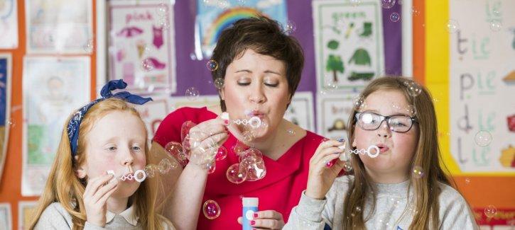 Children & Sarah O'Connor blowing bubbles