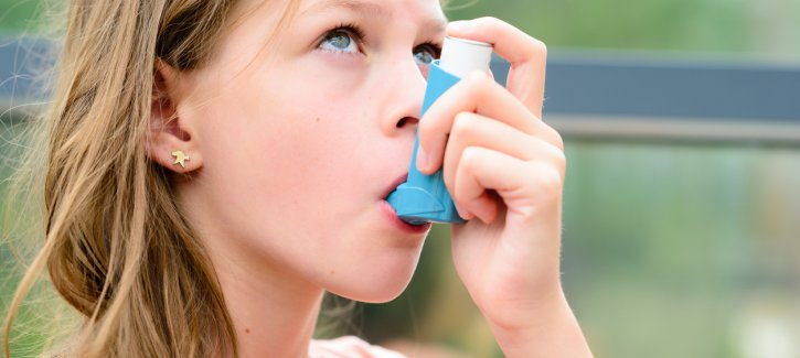 Girl taking ventolin inhaler