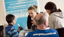 Asthma Specialist nurse talking to a mother and son